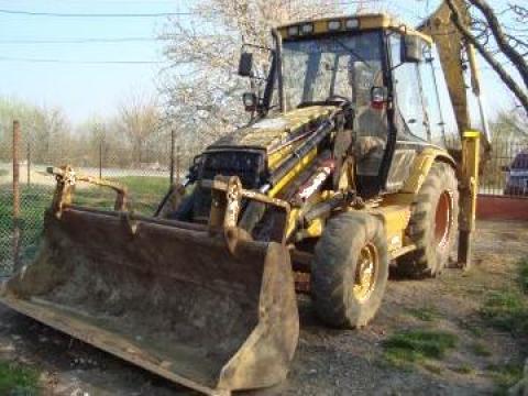 Inchiriere buldoexcavator Caterpillar de la Fancat