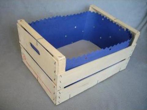 Hartie albastra ambalat mere in jurul laditelor